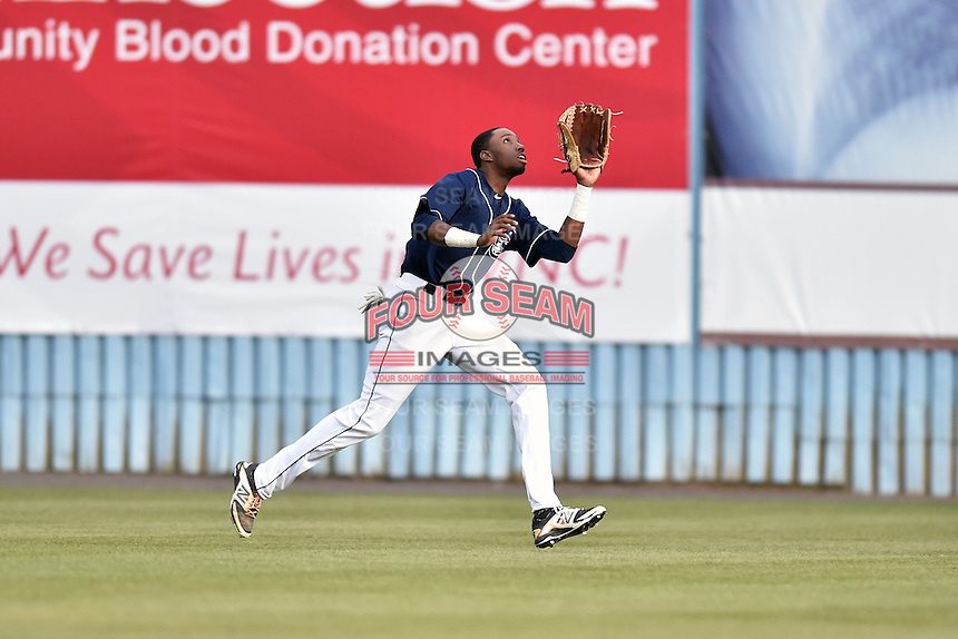 Asheville Tourists center fielder Wes Rogers (24) runs down a fly ball during game one of a double header against the Greenville Drive on April 18, 2015 in Asheville, North Carolina. The Tourists defeated the Drive 2-1. (Tony Farlow/Four Seam Images)
