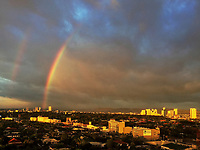 Rainbow and stormy Weather with dramatic clouds and light over Manila during the Monsoon Season