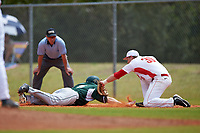 Illinois State Redbirds first baseman Brian Rodemoyer (30) tags Jordan Zimmerman (5) diving back to the bag on a pickoff attempt as umpire Kyle George looks on during a game against the Michigan State Spartans on March 8, 2016 at North Charlotte Regional Park in Port Charlotte, Florida.  Michigan State defeated Illinois State 15-0.  (Mike Janes/Four Seam Images)
