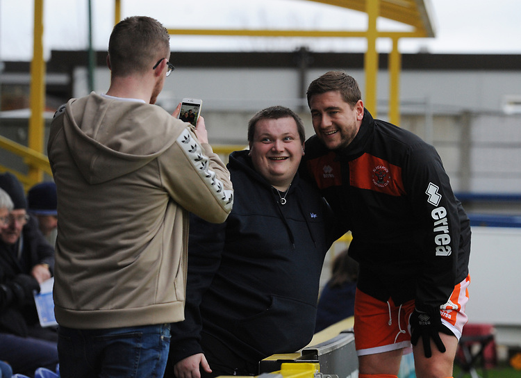 Blackpool's Steve Davies poses with a fan<br /> <br /> Photographer Kevin Barnes/CameraSport<br /> <br /> The EFL Sky Bet League One - AFC Wimbledon v Blackpool - Saturday 29th December 2018 - Kingsmeadow Stadium - London<br /> <br /> World Copyright © 2018 CameraSport. All rights reserved. 43 Linden Ave. Countesthorpe. Leicester. England. LE8 5PG - Tel: +44 (0) 116 277 4147 - admin@camerasport.com - www.camerasport.com