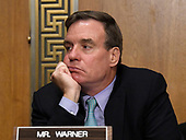 "United States Senator Mark Warner (Democrat of Virginia) watches as US Capitol Police arrest people in wheelchairs who were disrupting the US Senate Committee on Finance ""Hearing to Consider the Graham-Cassidy-Heller-Johnson Proposal"" on the repeal and replace of the Affordable Care Act (ACA) also known as ""ObamaCare"" in Washington, DC on Monday, September 25, 2017.<br /> Credit: Ron Sachs / CNP"