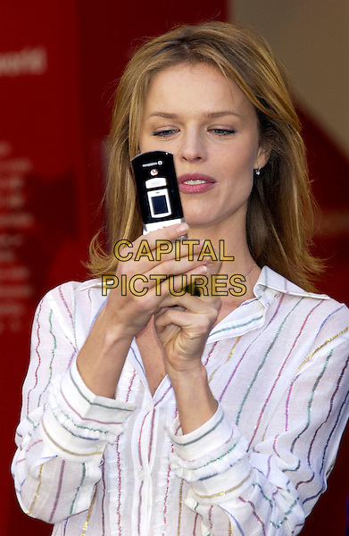 "EVA HERZIGOVA.launch  of ""Vodaphone live! with 3G"".high speedcamera phone.November 10th, 2004.Ref: PL.headshot, portrait, mobile phone, striped shir.www.capitalpictures.com.sales@capitalpictures.com.©Capital Pictures."