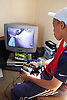 Young teenager playing with computer game,
