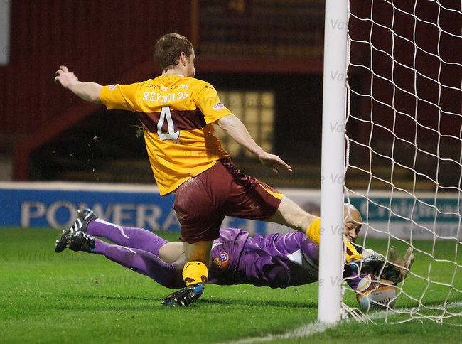 Motherwell keeper Darren Randolph and defender Mark Reynolds make a hash of clearing David Templeton's overhead kick for Hearts opening goal