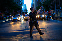 NEW YORK, NEW YORK - JULY 13:A NYPD officers directs traffic during a major power outage on July 13, 2019 in New York City. New Yorkers are without power as a major outage left portions of Manhattan, including Times Square and the Upper West Side with disrupting subway service across the city. (Photo by VIEWPRESS)