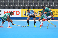Argentina's Manuel Brunet passes into the Pakistan D during the Hockey World League Quarter-Final match between Argentina and Pakistan at the Olympic Park, London, England on 22 June 2017. Photo by Steve McCarthy.
