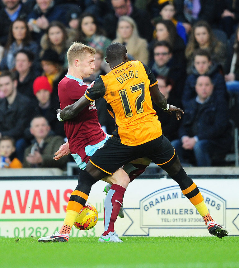 Burnley's Ben Mee vies for possession with Hull City's Mohamed Diame<br /> <br /> Photographer Chris Vaughan/CameraSport<br /> <br /> Football - The Football League Sky Bet Championship - Hull City v Burnley - Saturday 26th December 2015 - Kingston Communications Stadium - Hull<br /> <br /> &copy; CameraSport - 43 Linden Ave. Countesthorpe. Leicester. England. LE8 5PG - Tel: +44 (0) 116 277 4147 - admin@camerasport.com - www.camerasport.com