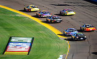Nov. 8, 2008; Avondale, AZ, USA; NASCAR Nationwide Series drivers race through turn two during the Hefty Odor Block 200 at Phoenix International Raceway. Mandatory Credit: Mark J. Rebilas-