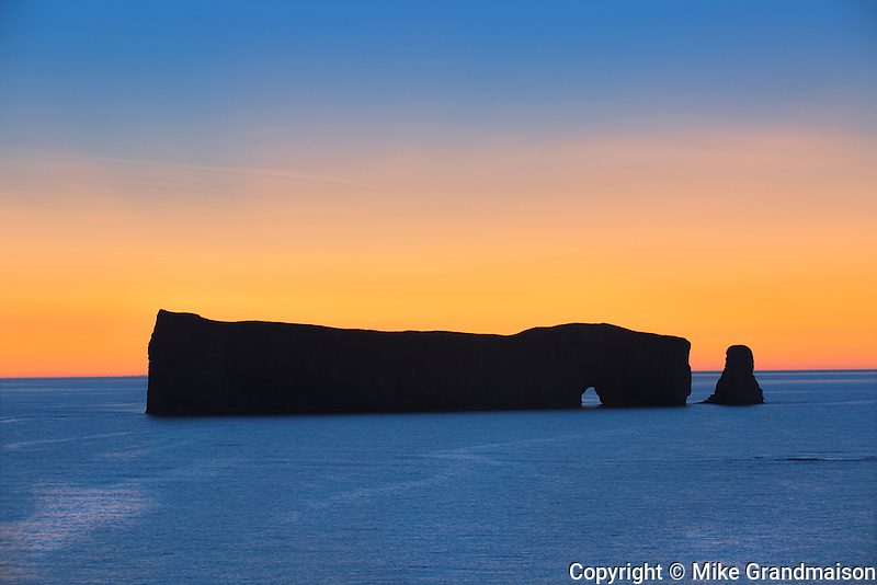 Roche Percé  on the Atlantic Ocean at dawn<br /> Percé <br /> Quebec<br /> Canada