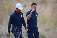 Thorbjorn Olesen (Team Europe) & Rory McIlroy (Team Europe) relaxed at the 8th during Friday's Fourballs, at the Ryder Cup, Le Golf National, Îls-de-France, France. 28/09/2018.<br /> Picture David Lloyd / Golffile.ie<br /> <br /> All photo usage must carry mandatory copyright credit (© Golffile | David Lloyd)