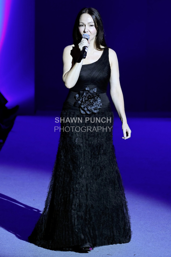 Singer Angeles Dominiguez performs on the runway during Couture Fashion Week at the Waldorf Astoria Hotel in New York City, on September 17, 2012.