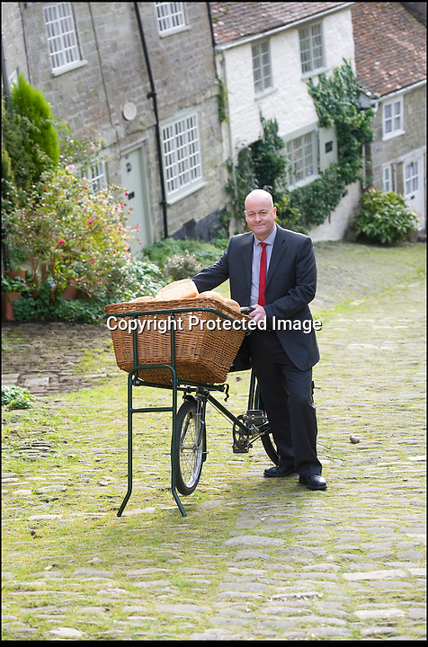 BNPS.co.uk (01202 558833)<br /> Pic: LauraJones/BNPS<br /> <br /> Carl Barlow yesterday recreated his famous scene from Ridley Scotts 1973 Hovis advert - Voted Britain's favourite.<br /> <br /> The child actor who starred in the famous Hovis TV advert today marked its 40th anniversary by returning to the iconic cobbled hill to push his bike up it again.<br /> <br /> Carl Barlow was aged 13 when he won the starring role as a bakery delivery boy for the TV commercial that has been voted as the nation's favourite.<br /> <br /> In the ad, the teenager was filmed struggling to push a bike laden with freshly baked bread up the steep hill to 'Old Ma Peggotty's house', the last customer on his round.<br /> <br /> The advert, directed by Ridley Scott, was meant to depict a northern industrial town but was actually shot on Gold Hill in Shafesbury, Dorset.