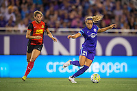 Orlando, Florida - Sunday, May 14, 2016: Orlando Pride defender Monica Hickman Alves (21) turns away from Western New York Flash forward Lynn Williams (9) during a National Women's Soccer League match between Orlando Pride and New York Flash at Camping World Stadium.