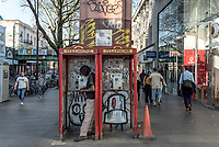 UK. London. 18th April 2018<br /> A man counts his money in a phone booth in Brixton.<br /> Andrew Testa for the New York Times