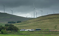 Clyde Wind Farm behind a farmhouse from Elvansfoot, South Lanarkshire, Scotland.