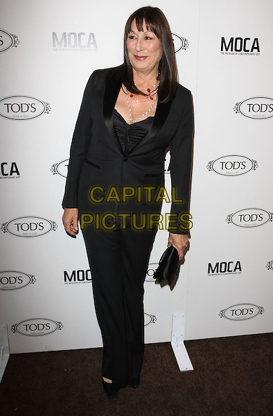 ANJELICA HUSTON.Tod's Beverly Hills boutique Grand Opening held At Tod's Boutique, Beverly Hills, California, USA. .April 15th, 2010 .full length suit trousers trouser jacket blazer clutch bag necklace smiling fringe pearls beads pearl black  .CAP/ADM/KB.©Kevan Brooks/AdMedia/Capital Pictures.