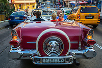 Tourist cruise in Havana, Cuba, in a convertible from the 50's.The number of U.S. visitors to Cuba is rising and rising as Cuba builds hotels, expands Havana airport to meet the booming demand.<br /> Tourism has increased sharply since Cuba and the United States announced announced their new relations and in 2016 received 4 million visitors, breaking all records and forecasts.