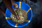 Neneh Fatmata Kamara, 15, prepares roasted peanuts to sell in the market in Mabella quarter, Freetown, Sierra Leone, Aug. 15, 2012. Médecins Sans Frontières Belgium, in collaboration with the Sierra Leone Ministry of Health, is running four emergency cholera treatment centers to keep up with the number of patients. Many of the roughly 120 daily patients seen by the MSF team come from extremely impoverished areas of the densely-populated capital, where proper systems for drainage and waste disposal are almost non-existent. Outbreaks of water-borne diseases like cholera become even more likely during the rainy season, which is expected to last at least two more months.