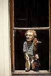 A marionette in a window in the busy downtown district of Prague, Czech Republic.