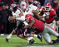 ATHENS, GA - NOVEMBER 23: Tyler Clark #52 of the Georgia Bulldogs sacks Kellen Mond #11 of the Texas A