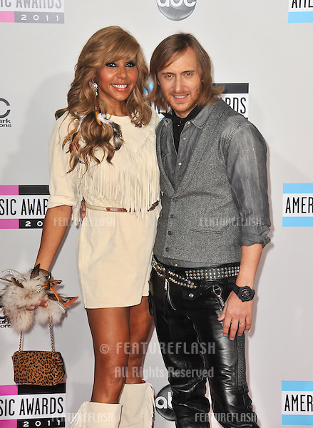 David Guetta & Cathy Guetta at the 2011 American Music Awards at the Nokia Theatre L.A. Live in downtown Los Angeles..November 20, 2011  Los Angeles, CA.Picture: Paul Smith / Featureflash