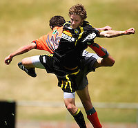 Wellington's Garry McDermott competes for the ball with Paul Stewart (16)..NZFC soccer  - Team Wellington v Waikato FC at Newtown Park, Wellington. Sunday, 20 December 2009. Photo: Dave Lintott/lintottphoto.co.nz