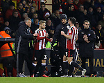 Harry Chapman of Sheffield Utd replaces Jake Wright of Sheffield Utd  during the English League One match at the Bramall Lane Stadium, Sheffield. Picture date: November 22nd, 2016. Pic Simon Bellis/Sportimage