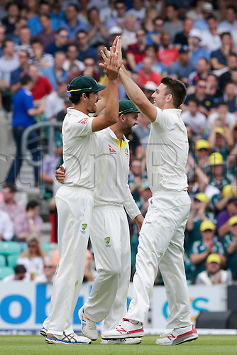 23.08.2015. London, England. Investec Ashes 5th Test, day 4.  England versus Australia.  Australia's Mitchell Marsh (right) celebrates with Australia's Mitchell Starc (left) after taking the wicket of England's Jos Buttler - c Starc b Marsh