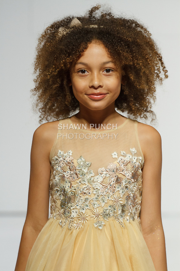 Model walks runway in an outfit from the Petite Adele collection by Sam Na, for the petitePARADE Spring Summer 2018 fashion show with Children's Club, at Javits Center in New York City, on August 7, 2017.