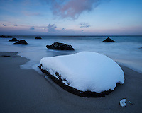 Snow covered Myrland beach in winter, Flakstadøy, Lofoten Islands, Norway