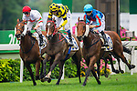 HONG KONG - MAY 04:  (R) Joao Moreira of Portugal riding Sun Pins competes with (C) Douglas Whyte of South Africa riding Lang Tai Sing and (L) Zac Purton of Australia riding Berlinski during the Causeway Bay Plate at Sha Tin racecourse on May 4, 2014 in Hong Kong, Hong Kong.  Photo by Aitor Alcalde / Power Sport Images