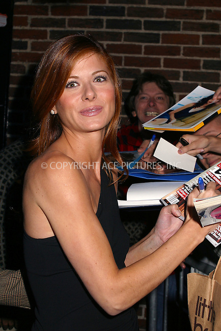 """Actress Debra Messing departs from Ed Sullivan Theater in New York after making an appearance on """"The Late Show With David Letterman."""" October 14, 2002. Please byline: Alecsey Boldeskul/NY Photo Press.   ..*PAY-PER-USE*      ....NY Photo Press:  ..phone (646) 267-6913;   ..e-mail: info@nyphotopress.com"""