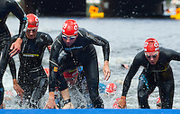 17 JUL 2011 - HAMBURG, GER - Competitors scramble up the ramp  at the end of the first swim lap during the women's Hamburg round of triathlon's ITU World Championship Series .(PHOTO (C) NIGEL FARROW)