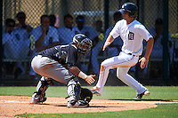 GCL Yankees 1 catcher Jerry Seitz (78) waits for a throw as Aaron Sayers (14) slides home during the first game of a doubleheader against the GCL Tigers on August 5, 2015 at Tigertown in Lakeland, Florida.  GCL Tigers derated the GCL Yankees 5-2.  (Mike Janes/Four Seam Images)