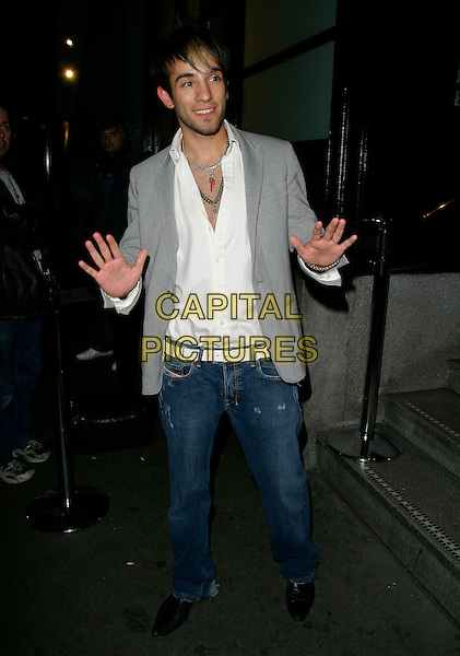 """SEZER YURTSEVEN.At the UK Film Premiere of """"You, Me & Dupree"""",.Odeon Leicester Square, London, England, .August 22nd 2006..full length hands funny pose gesture grey jacket jeans white shirt big brother 7.Ref: AH.www.capitalpictures.com.sales@capitalpictures.com.©Adam Houghton/Capital Pictures."""