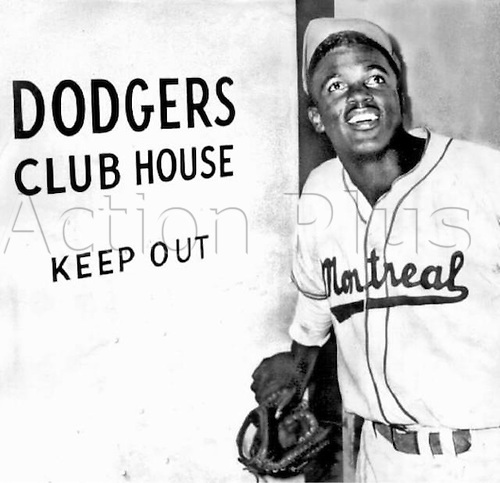 1947. Jackie Robinson, still in his Montreal Royals uniform, reacts after the Brooklyn Dodgers announce they had purchased his contract in April 1947. Robinson broke the colour barrier in professional sports when he became the first African-American player to compete in major league baseball.