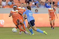 Houston, TX - Friday April 29, 2016: Chioma Ubogagu (9) of the Houston Dash attempts to dribble the ball around Ashley Nick (10) of Sky Blue FC at BBVA Compass Stadium. The Houston Dash tied Sky Blue FC 0-0.