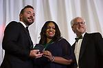 Cherron Payne accepts a Medal of Merit at the Alumni Awards Gala on October 6, 2017.