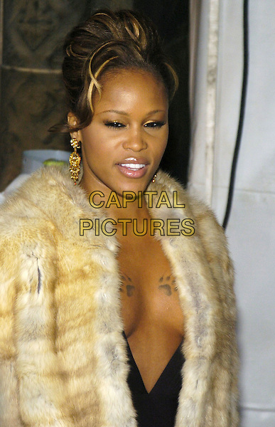 EVE.Black tie gala benefit for amfAR, the foundation for AIDS research, at Cipriani on 42nd Street, New York, New York, USA..January 31st, 2007.half length tattoos beige fur coat gold earrings low cut plunging neckline cleavage.CAP/ADM/BL.©Bill Lyons/AdMedia/Capital Pictures *** Local Caption ***