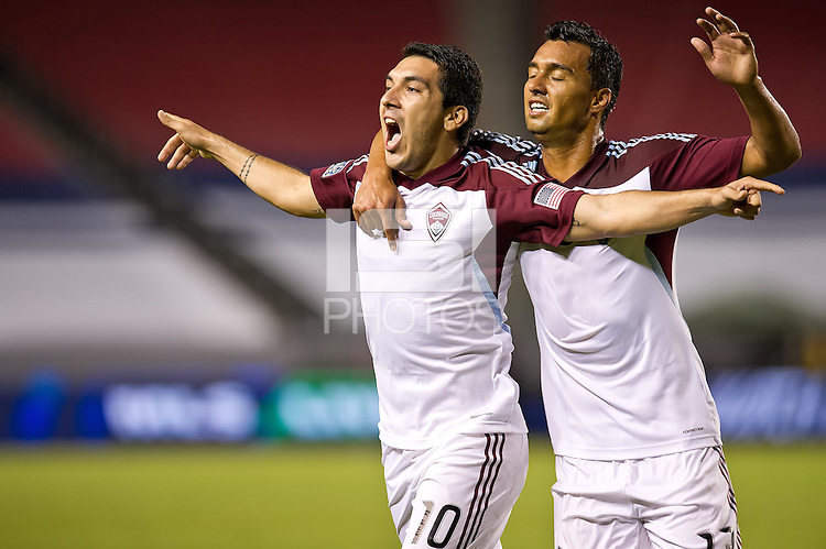 CARSON, CA - October 20, 2012: Colorado midfielder Martin Rivero (10) and forward Kamani Hil (13) celebrate Rivero's goal during the Chivas USA vs Colorado Rapids match at the Home Depot Center in Carson, California. Final score, Chivas USA 0, Colorado Rapids 2.