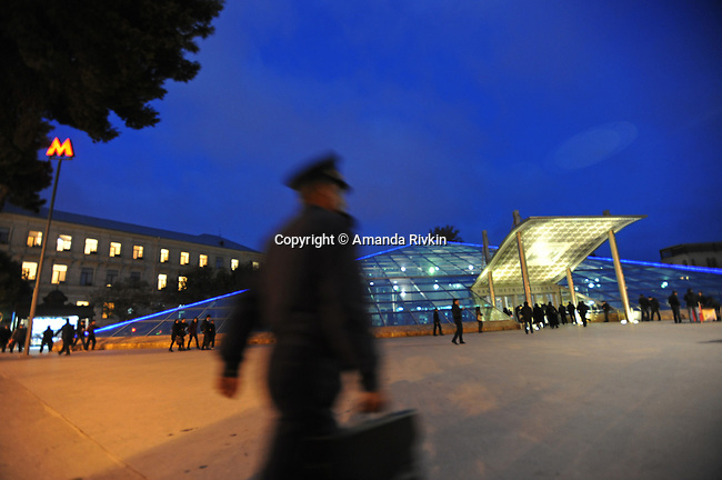 A policeman with a briefcase walks passed the Baksoviet or Icherishahar or Old City Metro Station at the entrance to the Old City of Baku, Azerbaijan on November 16, 2011.