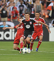 Alain Rochat (25) of D.C. United goes against Bobby Convey (15) and Luis Silva (11) of Toronto FC. Toronto FC defeated D.C. United 2-1, at RFK Stadium, Saturday June 15 , 2013.