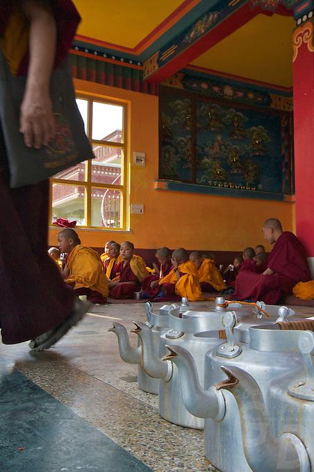 Masala tea Pots and Buddhist Tibetan Monks during a Prayer and lecture at the Kopan Monastery Kathmandu