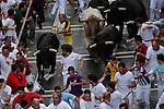 Second day of running bull during San Fermin festival 2014, in Pamplona, Spain. Revelers from around the world arrive to Pamplona every year to take part in the running bulls of San Fermin. Photo by Jose Luis Cuesta.