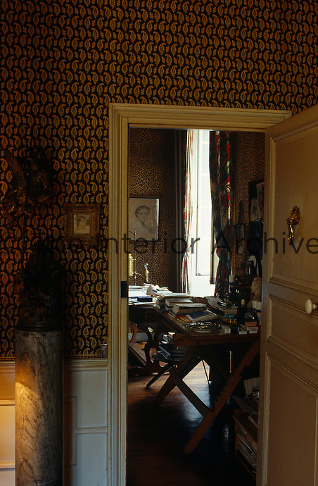A view into Jean Cocteau's study with its cluttered desks