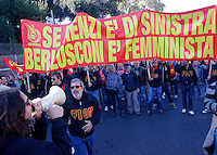 Manifestazione della CGIL contro il Jobs Act del governo, a Palazzo Chigi, Roma, 25 ottobre 2014.<br /> CGIL union demonstration against the government's Jobs Act labour reform, in Rome, 25 October 2014. The banner reads 'If Renzi is leftist Berlusconi is feminist'.<br /> UPDATE IMAGES PRESS/Riccardo De Luca