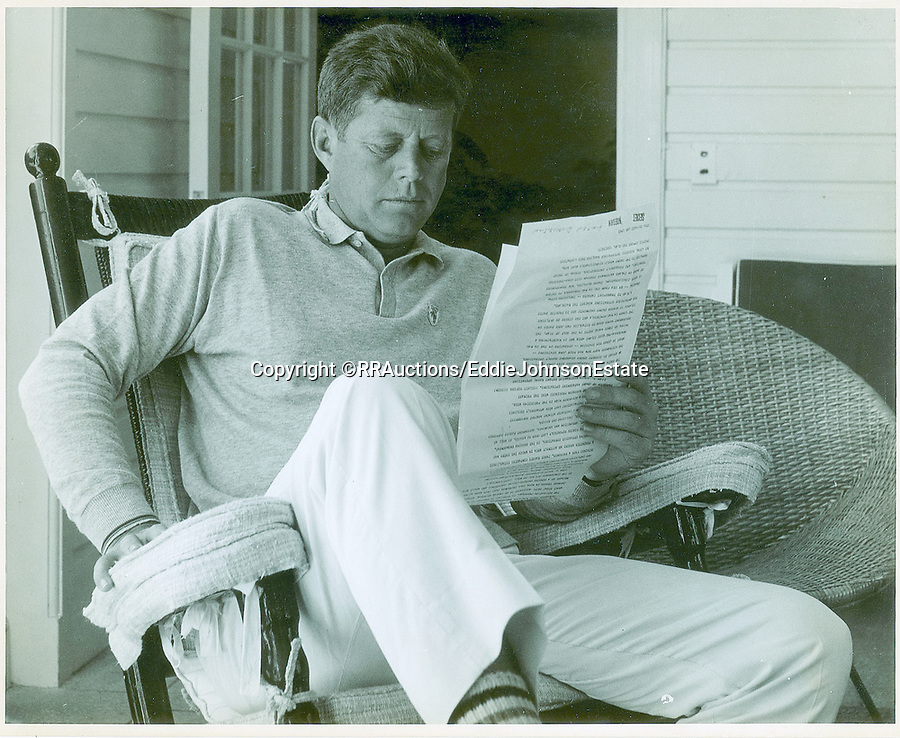 BNPS.co.uk (01202 558833)<br /> Pic: RR/EddieJohnsonEstate/BNPS<br /> <br /> Candid never before seen photos of President Kennedy on a 'working holiday' less than a year before he was assassinated have come to light.<br /> <br /> The fascinating snaps show John F Kennedy at work and relaxing at his idyllic Palm Beach residence, his 'Winter White House', in December 1962 and January 1963.<br /> <br /> He can be seen reading documents while sat on his patio, chatting with one of his advisers and taking a break from official business to soak up the sun in his garden.<br /> <br /> While this was going on, Kennedy was having his portrait drawn by celebrated artist of the age Elaine de Kooning.