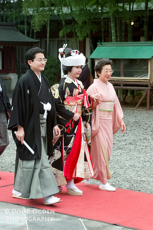 The bride with mother and father, traditional dress,  Tokyo, Japan