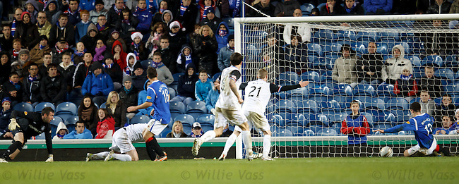 Lee Wallace clears the ball off the line to save Rangers