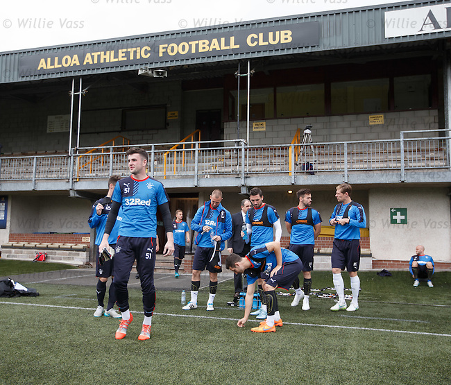 Rangers team arrives at Alloa's Indodrill Stadium to train on their synthetic surface ahead of the match on Sunday, Lee Wallace inspects the pitch
